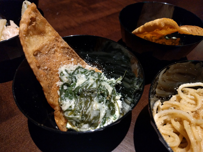 A tasting of the artichoke dip and lobster pasta